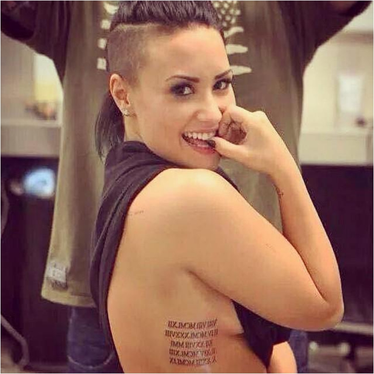 Demi Lovato's 15 Tattoos And Their Meaning