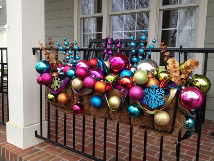 christmas ornaments on outdoor railings