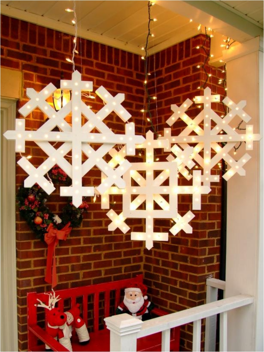 diy glowing wooden snowflakes 24 festive ideas for outdoor christmas decorations