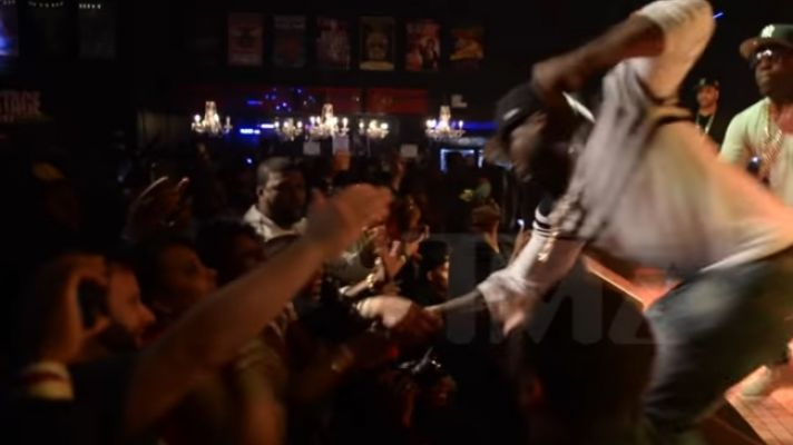 50 Cent Aggressively Punches Fan for Pulling Him Off Stage
